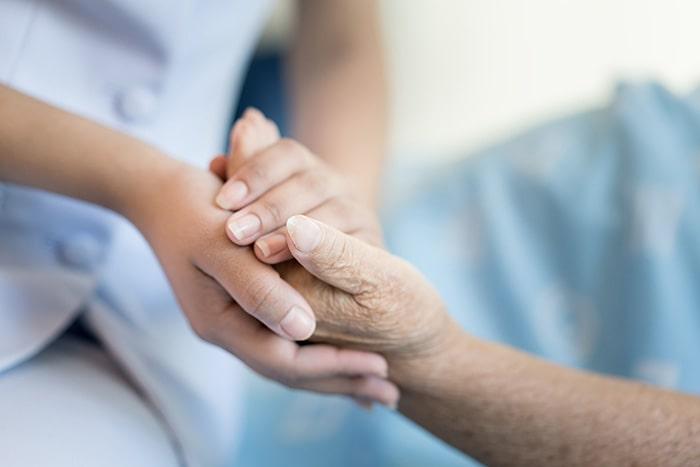 Carer holding hands